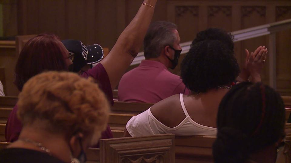 Pastor Jeremy Hollingshead hosted the Stop the Violence prayer walk at the Martin Luther Lutheran Church on the south side after it was moved indoors because of weather.