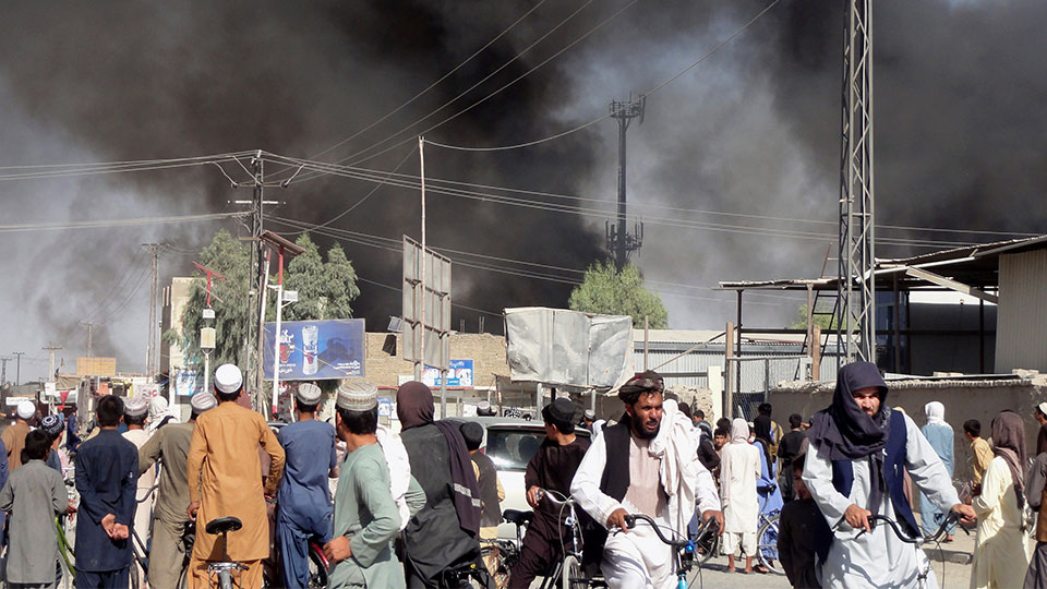 Smoke rises after fighting between the Taliban and Afghan security personnel in the city of Kandahar, southwest of Kabul, Afghanistan, Thursday, Aug. 12, 2021