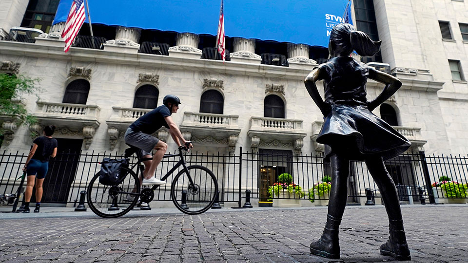 The Fearless Girl statue faces the New York Stock Exchange, Tuesday, July 20, 2021.