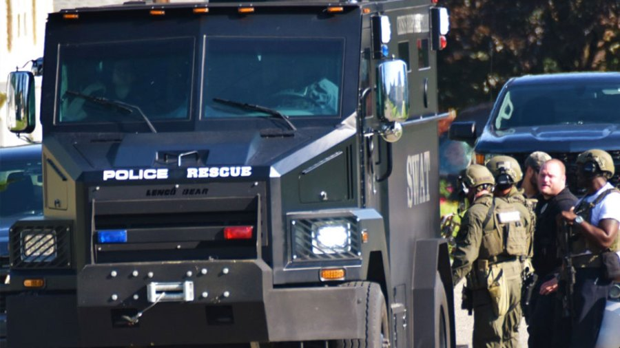 The Bear, the armored assault vehicle for the Mahoning Valley Crisis Response Team, stands by Wednesday as CRT members wait to search a house on North Bon Air Avenue in Youngstown for a suspect in a double homicide Tuesday. The suspect was not there.