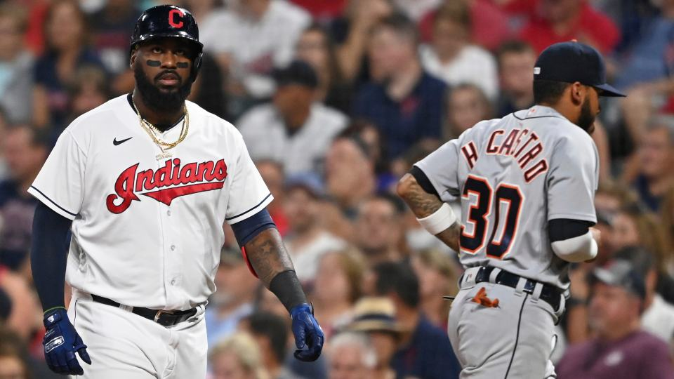 Cleveland Indians' Franmil Reyes, left, reacts after grounding out with the bases loaded in the sixth inning of a baseball game against the Detroit Tigers, Saturday, Aug. 7, 2021, in Cleveland. (AP Photo/David Dermer)