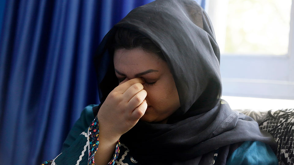 Zarmina Kakar a women's rights activist cry during an interview with The Associated Press in Kabul, Afghanistan, Friday, Aug. 13, 2021.