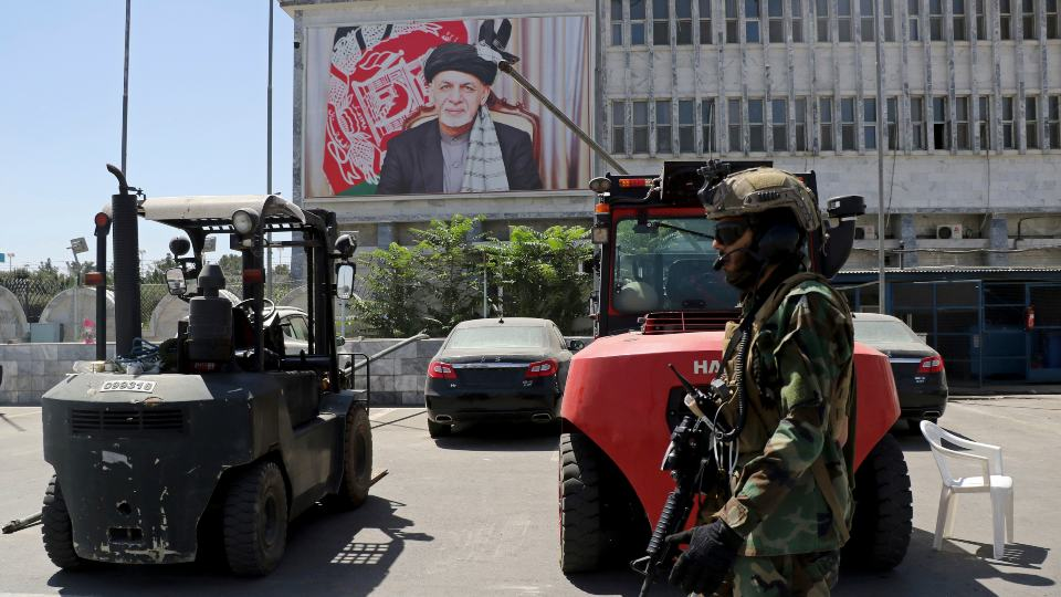 A Taliban soldier patrols at Hamid Karzai International Airport in Kabul, Afghanistan, Sunday, Sept. 5, 2021. Some domestic flights have resumed at Kabul's airport, with the state-run Ariana Afghan Airlines operating flights to three provinces. (AP Photo/Wali Sabawoon)