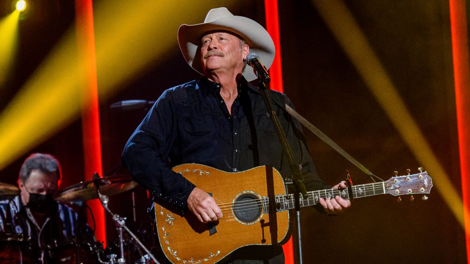 Country superstar Alan Jackson revealed in an interview Tuesday that he has a degenerative nerve condition that affects his balance but he intends to keep performing.
