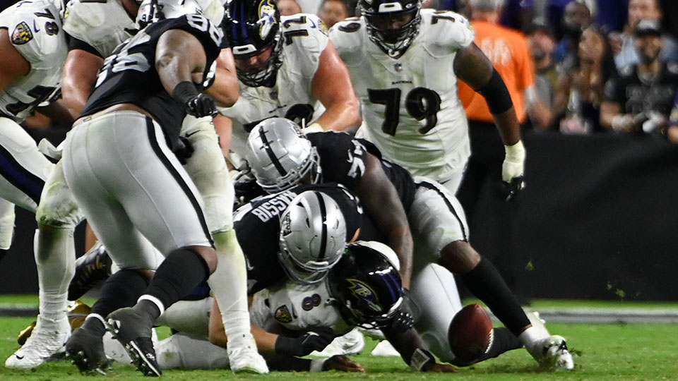 Las Vegas Raiders defensive end Carl Nassib (94) forces a fumble by Baltimore Ravens quarterback Lamar Jackson (8) during overtime in an NFL football game, Monday, Sept. 13, 2021, in Las Vegas