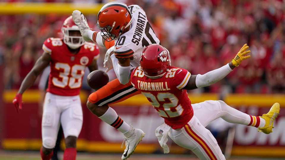 Kansas City Chiefs safety Juan Thornhill (22) breaks up a pass intended for Cleveland Browns wide receiver Anthony Schwartz (10) during the second half of an NFL football game Sunday, Sept. 12, 2021, in Kansas City, Mo.