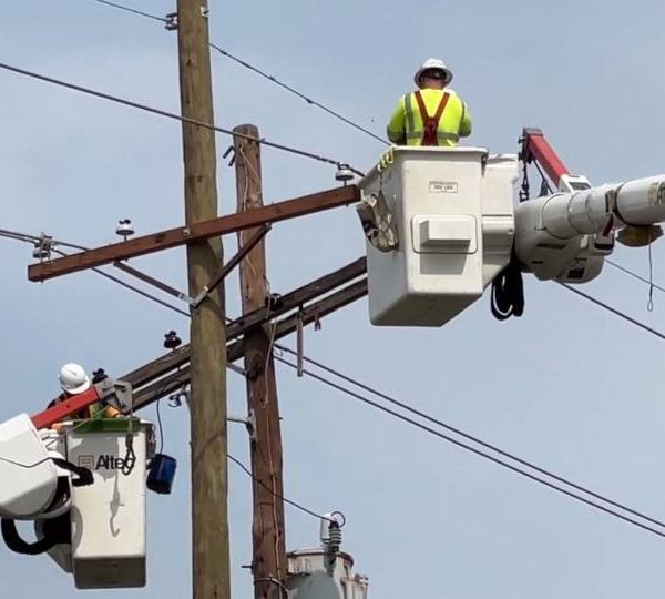 About 50 local crew members are working to restore miles of power lines, and are starting from scratch to rebuild the power system in some areas.