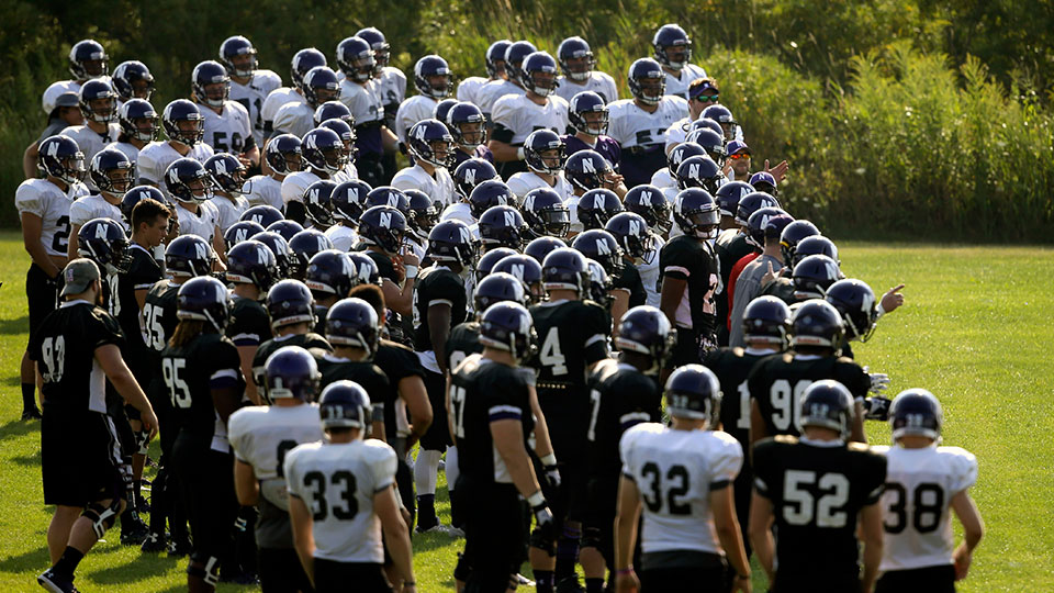 Northwestern football players gather during practice at the University of Wisconsin-Parkside campus in Kenosha, Wisc., in this Monday, Aug. 17, 2015