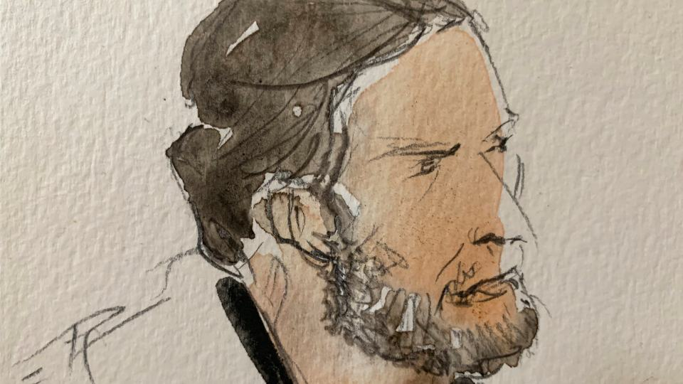 This courtroom sketch shows key defendant Salah Abdeslam, in the special courtroom built for the 2015 attacks trial, Wednesday, Sept. 8, 2021 in Paris. The trial of 20 men accused in the Islamic State group's coordinated attacks on Paris in 2015 that transformed France opened Wednesday in a custom-built complex embedded within a 13th-century courthouse. (Noelle Herrenschmidt via AP)