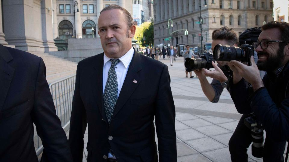 FILE - In this Oct. 23, 2019 file photo, Igor Fruman, left, arrives for his arraignment in New York. U.S. Plans for Fruman, who assisted Rudy Giuliani in seeking damaging information about Joe Biden in Ukraine when Biden was running for president and Giuliani was serving as a personal attorney to then-President Donald Trump, to plead guilty in an illegal campaign contribution case are being delayed a few weeks, a court filing said Tuesday, Aug. 24, 2021. A filing Tuesday said the change-of-plea proceeding will now take place Sept. 10 at the request of Fruman's lawyer. (AP Photo/Mark Lennihan, File)