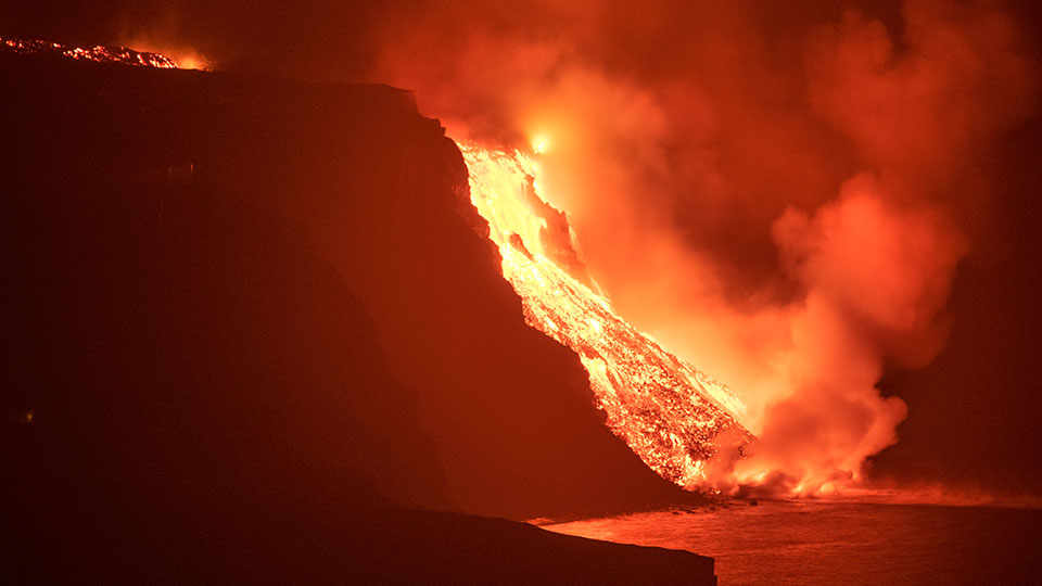 Lava from a volcano reaches the sea on the Canary island of La Palma, Spain in the early hours of Wednesday Sept. 29, 2021