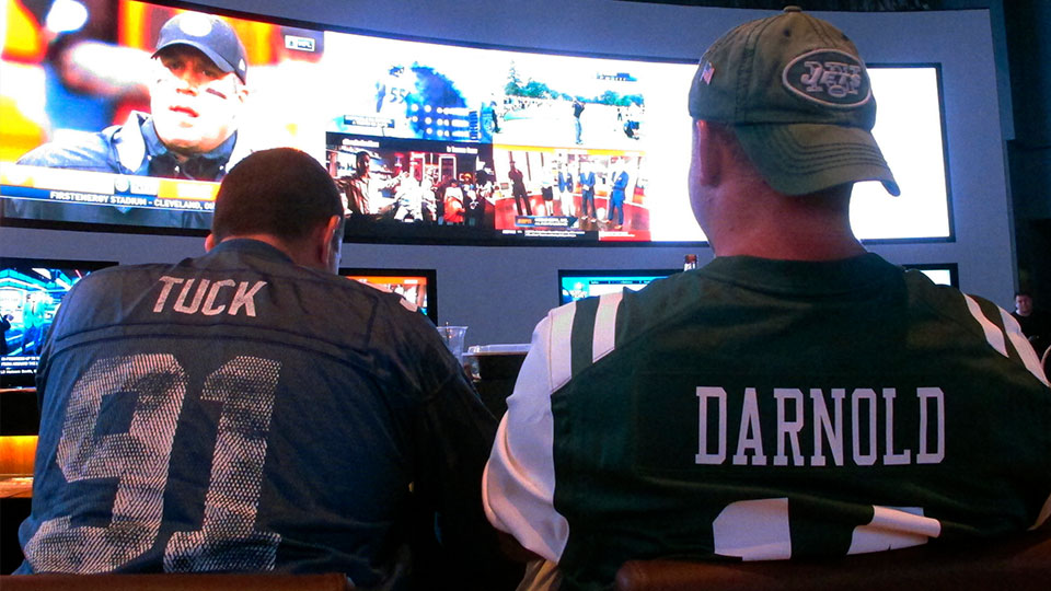 New York Giants and Jets watching a football game after placing bets in the sports betting lounge at the Ocean Casino Resort in Atlantic City, N.J. The American Gaming Association projects that 45.2 million Americans will bet on the NFL this season