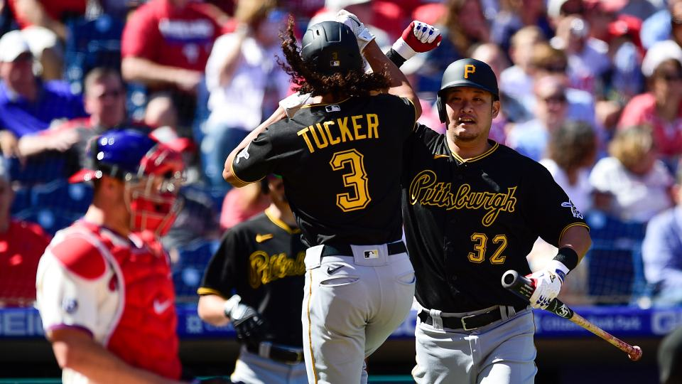 Pittsburgh Pirates' Cole Tucker (3) celebrates with Yoshi Tsutsugo, right, after hitting a solo home run off Philadelphia Phillies staring pitcher Hans Crouse during the first inning of a baseball game, Sunday, Sept. 26, 2021, in Philadelphia. (AP Photo/Derik Hamilton)