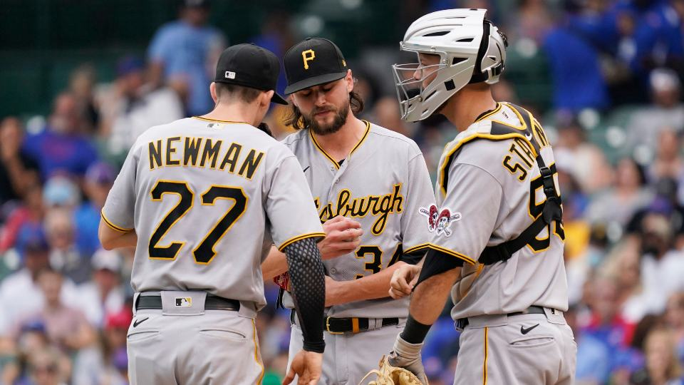 Pittsburgh Pirates starting pitcher JT Brubaker, center, reacts as he talks with shortstop Kevin Newman, left, and catcher Jacob Stallings during the fourth inning of a baseball game against the Chicago Cubs in Chicago, Saturday, Sept. 4, 2021. (AP Photo/Nam Y. Huh)