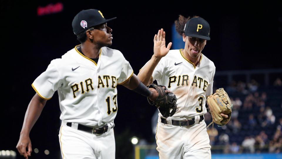 Pittsburgh Pirates third baseman Ke'Bryan Hayes (13) and Pittsburgh Pirates shortstop Cole Tucker (3) high-five in the fifth inning of a baseball game against the Washington Nationals, Saturday, Sept. 11, 2021, in Pittsburgh. (AP Photo/Rebecca Droke)