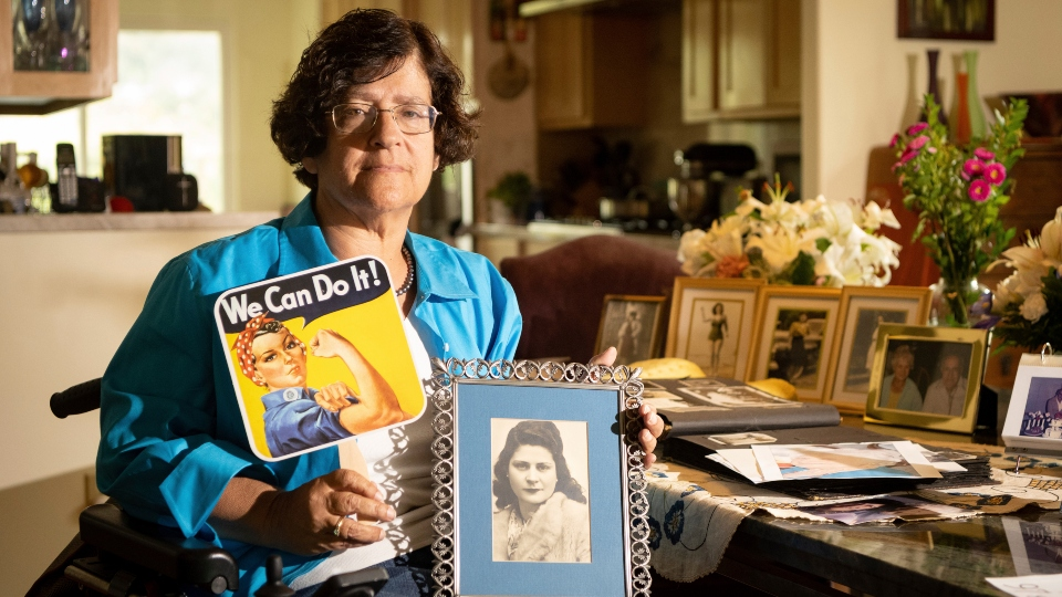 Dorene Giacopini holds up a photo of her mother Primetta Giacopini while posing for a photo at her home in Richmond, Calif. on Monday, Sept 27, 2021. Primetta Giacopini's life ended the way it began — in a pandemic. She was two years old when she lost her mother to the Spanish flu in Connecticut in 1918. Giacopini contracted COVID-19 earlier this month. The 105-year-old struggled with the disease for a week before she died Sept. 16.