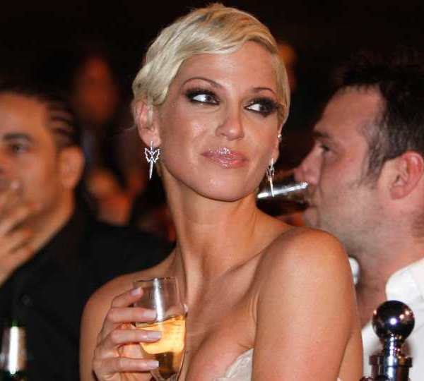 In this Wednesday, Feb. 18, 2009 file photo, Singer Sarah Harding from British band Girls Aloud, attends the Brit Awards 2009 ceremony at Earls Court exhibition centre in London, England, Wednesday, Feb. 18, 2009. Harding, of British pop group Girls Aloud, has died after a battle with breast cancer, her mother said Sunday, Sept. 5, 2021. She was 39. The singer said last August that she had been diagnosed with breast cancer and it had spread to other parts of her body.