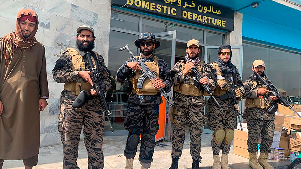 Taliban fighters stand guard inside the Hamid Karzai International Airport after the U.S. withdrawal in Kabul, Afghanistan, Tuesday, Aug. 31, 2021