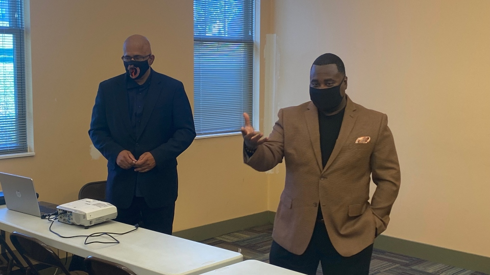 Tio Hardman, left, of Violence Interrupters; and Guy Burney, of the Youngstown CIRV; speak at a training session Thursday at the Arlington Heights Community Center.