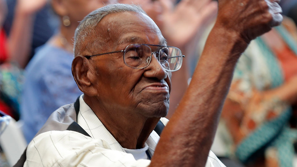 World War II veteran Lawrence Brooks celebrates his 110th birthday at the National World War II Museum in New Orleans