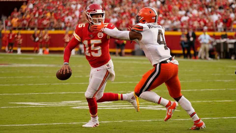 Kansas City Chiefs quarterback Patrick Mahomes (15) scrabbles away from Cleveland Browns linebacker Anthony Walker Jr. (4) during the second half of an NFL football game Sunday, Sept. 12, 2021, in Kansas City, Mo.