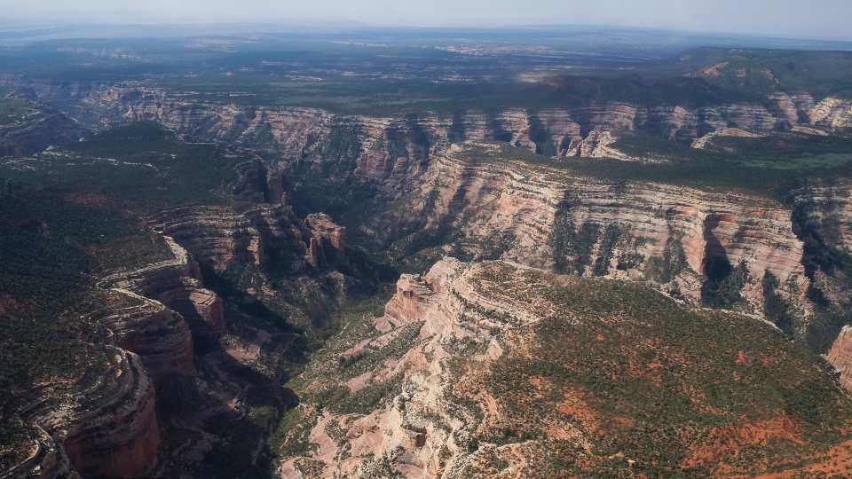This May 8, 2017 aerial file photo shows Arch Canyon within Bears Ears National Monument on May 8, 2017, in Utah. President Joe Biden will expand two sprawling national monuments in Utah that have been at the center of a public lands tug-of-war that has played out over three presidential administrations, the state's governor said Thursday, Oct. 7, 2021.