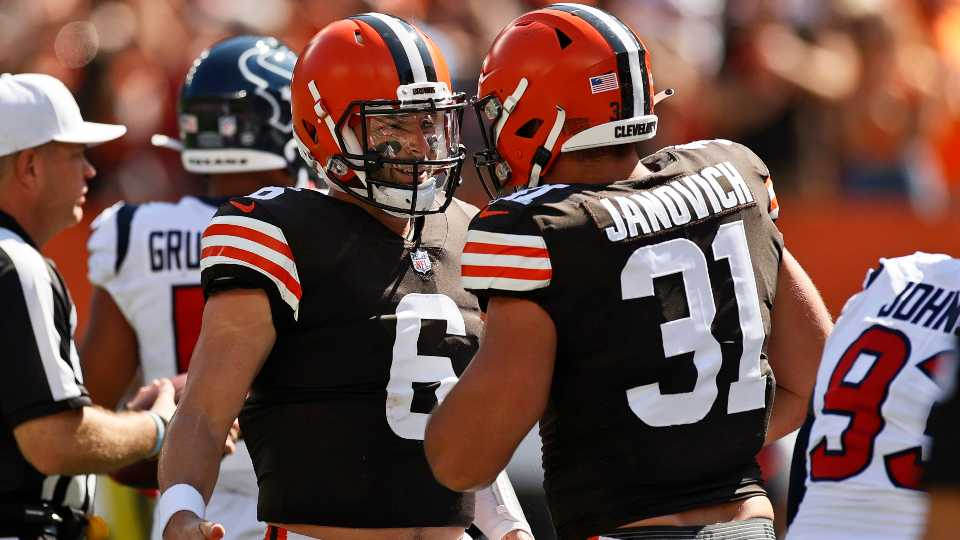 Cleveland Browns quarterback Baker Mayfield, left, celebrates with Andy Janovich after Janovich scored a one-yard touchdown during the first half of an NFL football game against the Houston Texans, Sunday, Sept. 19, 2021, in Cleveland