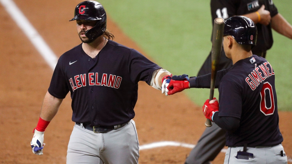 Cleveland Indians Austin Hedges (17) is greeted by Andres Gimenez (0) after scoring on a solo home run against the Texas Rangers in the third inning of a baseball game Friday, Oct. 1, 2021, in Fort Worth, Texas.