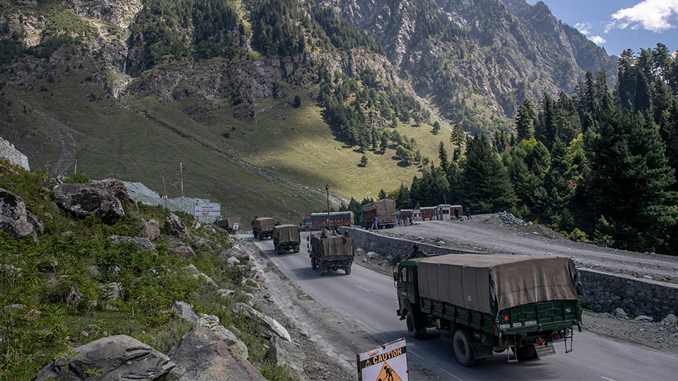 Indian army convoy moves on the Srinagar- Ladakh highway at Gagangeer, northeast of Srinagar, Indian-controlled Kashmir. Indian and Chinese army commanders met Sunday, Oct. 10, 2021