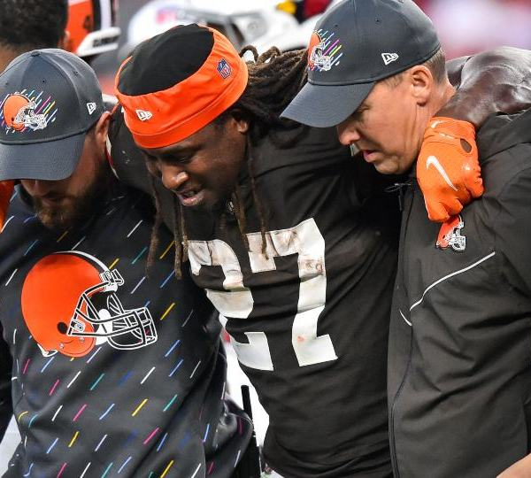 Cleveland Browns running back Kareem Hunt (27) is helped off the field after an injury during the second half of an NFL football game against the Arizona Cardinals, Sunday, Oct. 17, 2021, in Cleveland. (AP Photo/David Richard)