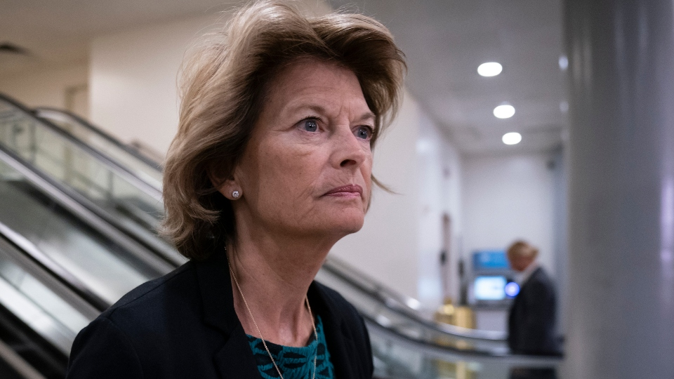 FILE - In this Jan. 8, 2020, file photo Sen. Lisa Murkowski, R-Alaska, heads to a briefing on Capitol Hill in Washington. An Alaska man faces federal charges after authorities allege he threatened to hire an assassin to kill Murkowski, according to court documents unsealed Wed., Oct. 6, 2021.