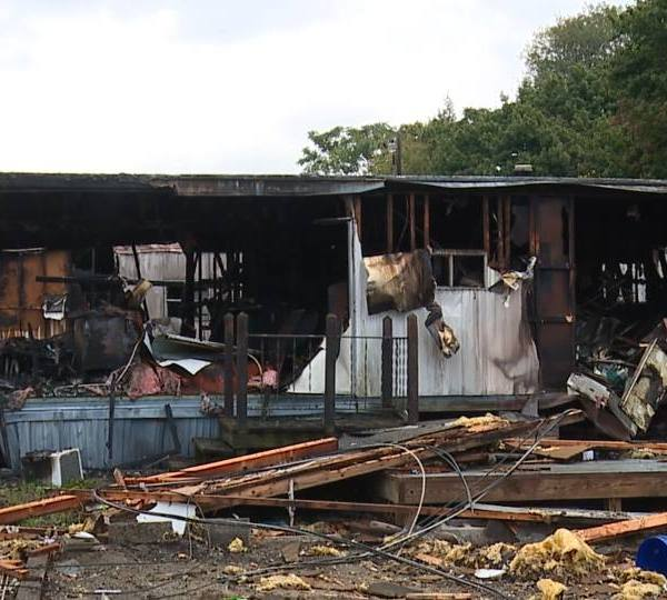 Two families lost their New Castle homes -- in a fire from a debris pile which got out of control.