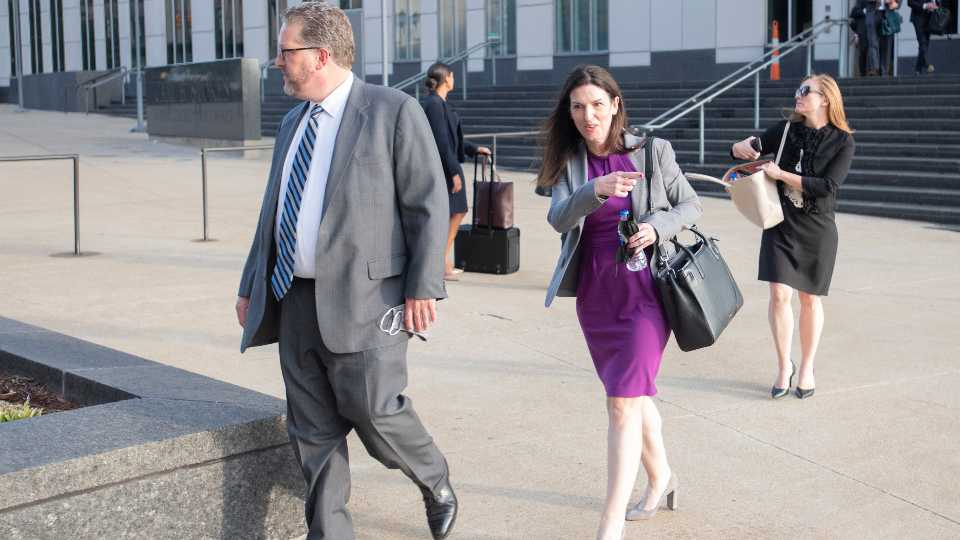 Attorneys and staff associated with a federal trial of pharmacies, CVS, Walgreens, Giant Eagle and Walmart leave the Carl B. Stokes Federal Courthouse in Cleveland, Monday, Oct. 4, 2021. The pharmacies are being sued by Ohio counties Lake and Trumbull for their part in the opioid crisis.