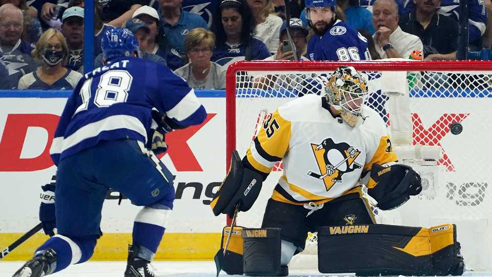 Pittsburgh Penguins goaltender Tristan Jarry (35) makes a save on a shot by Tampa Bay Lightning left wing Ondrej Palat (18) during the first period of an NHL hockey game Tuesday, Oct. 12, 2021, in Tampa, Fla.