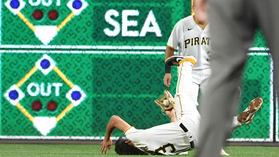 Pittsburgh Pirates' Cole Tucker (3) makes a diving catch for an out in the seventh inning against the Cincinnati Reds during a baseball game in Pittsburgh, Friday, Oct. 1, 2021.