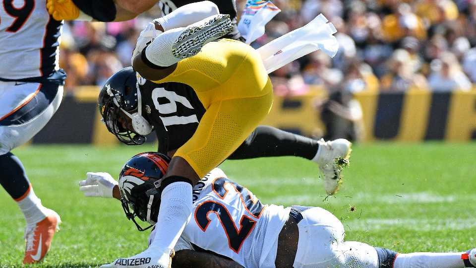 Pittsburgh Steelers wide receiver JuJu Smith-Schuster (19) is upended by Denver Broncos safety Kareem Jackson (22) during the first half of an NFL football game in Pittsburgh, Sunday, Oct. 10, 2021. Smith-Shuster was injured on the play and left the field.
