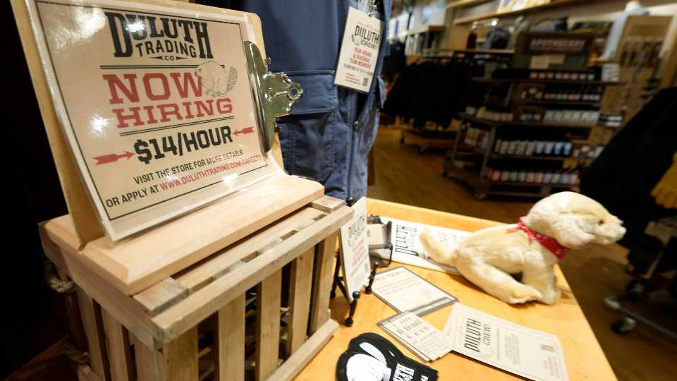 A now hiring sign sits on a display in a clothing store Saturday, Oct. 9, 2021, in Sioux Falls, S.D.